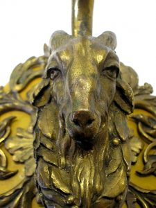 Rare Georgian bronze wall sconce, featuring a goat's head, mounted on a wooden plinth.