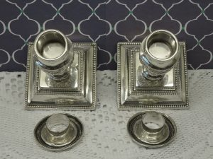 Pair of solid silver Victorian short candlesticks, Barker Brothers, Birmingham, date 1899. Neoclassical Grecian urn square base. Hallmarked.