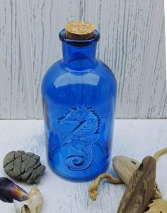 Large blue bottle, embossed seahorse, cork stopper. Bubble bath, shampoo bottle, dispenser. Coastal, marine, nautical, seaside, beach decor
