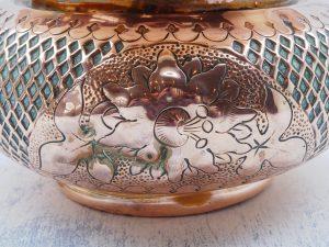 Art Nouveau copper jardiniere. Victorian copper planter with floral motifs.