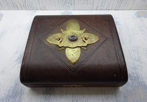Victorian Gothic leather jewellery box, eyeball agate cabochon, Gothic stylised brass cross, blue satin lining, tooled leather, Victoriana