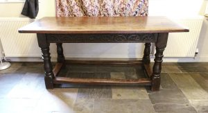 """17th century style oak refectory table - 5'6"""" long. Early 20th century oak wood dining table with stretchers, carved rails & turned legs."""