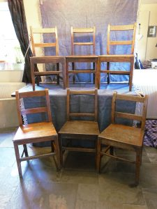 Set of six late Georgian fruitwood chairs. A harlequin set of six early 19th Century rustic dining chairs for restoration. Antique chairs