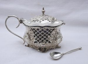 Solid silver Edwardian mustard pot with cobalt liner and spoon, Baroque style. By Colen Hewel, Chester 1902, spoon by Horace Woodward & Co