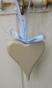 Wood heart with ribbons, rustic hand painted sand colour. Seaside coastal beach hut decoration.