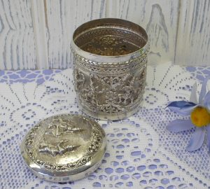Antique solid silver Burmese betel box or tea caddy. Engraved R A W Hoare. Repoussé & engraved silver canister with lid, traditional figures