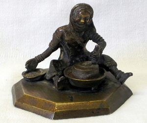 Antique Indian bronze figure grinding corn