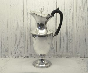 Victorian silver plated claret jug by Walker & Hall. Urn shaped pitcher with lid and ebony handle. Helmet shape claret jug. Victorian ewer