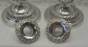 A 19th century pair of Baroque style silver plated candlesticks