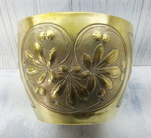 Antique French brass jardiniere depicting repoussé horse chestnut design