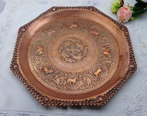 Antique Indian copper tray, octagonal tray with repoussé pheasants, holy cows, horses, elephants, lions.