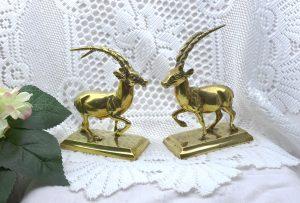 Vintage brass Scimitar Oryx ornaments, pair. Brass Sahara Oryx figurines, on plinths.