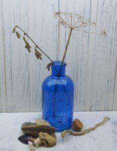 Large blue bottle, embossed seahorse, cork stopper. Bubble bath, shampoo bottle, dispenser. Coastal, marine, nautical, seaside, beach decor