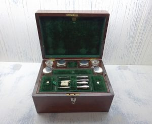 Georgian Rosewood travelling vanity box, green velvet lined, silver plated topped bottles, solid silver handled manicure set, mirror, drawer
