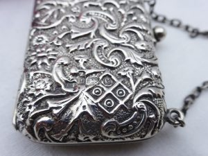 Edwardian solid silver miniature purse, by Lawrence Emanuel, Birmingham 1902. Sterling silver repoussé purse on a chain, blue satin lining