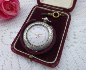 Antique silver Swiss ladies pocket watch, in working order, with key and in original red velvet covered presentation box, late Victorian