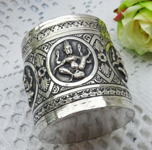 Antique solid silver Burmese betel nut box. Repoussé & engraved silver canister with lid, traditional figures, betel leaf box, trinket pot