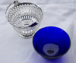 Silver Edwardian basket sugar basin with cobalt blue glass liner by Barker Brothers, Chester 1907. Pierced solid silver bowl, swing handle