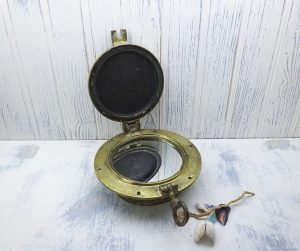 Antique bronze porthole with mirror each side and storm cover / deadlight with dog ear. Bull's eye. Vintage marine, yacht, nautical decor