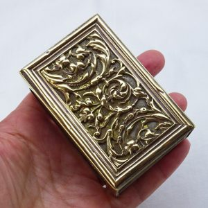Vintage brass matchbox holder featuring a Baroque acanthus leaf design. With a vintage French empty matchbox. Tobacciana, smoking accessory