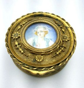 19th century French ormolu box, with a painted miniature of a lady