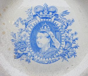 Victorian tea plate commemorating Queen Victoria's diamond jubilee, 50 years reign, 1837-1897. White pottery with blue transfer print.