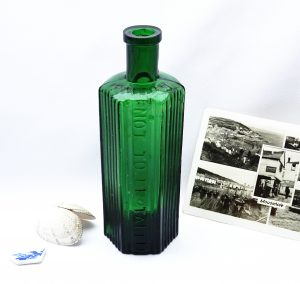 Antique green hexagonal Not To Be Taken poison bottle, 8 oz