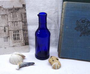 Victorian faceted cobalt blue bulk ink bottle with pouring lip, rare, faceted sides. Bulk ink bottle with spout. Scarce antique cobalt ink.
