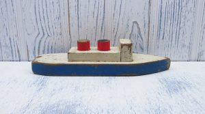 Vintage wooden boat model, steamer ferry, pleasure cruise boat. Home made, rustic shabby chic, primitive wood boat