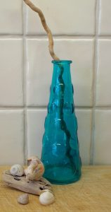 Vintage turquoise bottle. Turquoise Bathroom decor, bud vase, surfaced coloured glass, coastal decor, shampoo bottle, bubble bath bottle