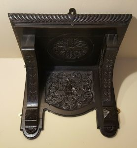 Victorian carved oak clock bracket shelf with green man theme