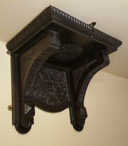 Victorian carved oak clock bracket shelf with green man theme