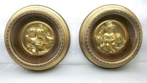 A very decorative pair of gilt plaster plaques by E.W Wyon.