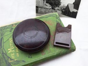 Wunup Baccyflap and Clubs Bakelite vesta case. Bakelite tobacco container in mottled red-brown and mottled brown matchstick holder.