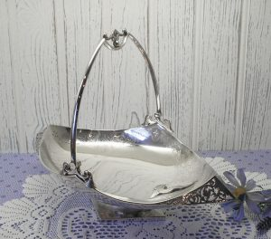 Victorian silver plated breadbasket by Lee & Wigfull. Swing handled bread basket, boat shaped breadbasket, silver plate pedestal breadbasket