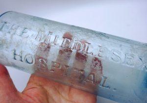Antique aqua glass bottle embossed 'The Middlesex Hospital'. Victorian medicine bottle, apothecary bottle, pharmacy, chemist bottle, medical