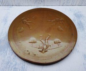 Vintage Vietnamese copper tray or platter, depicting three repoussé paddy field labourers in coolie hats. Early to mid century, pot stand