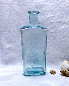 Antique rare aqua bottle embossed 'G. C. Druce Chemist Oxford', with graduated measures. Victorian graduated medicine bottle, circa 1890
