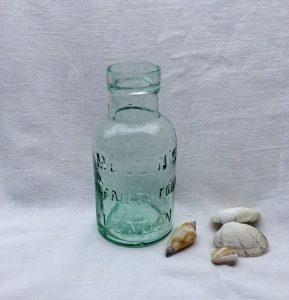 Antique aqua glass bottle ~ Mellin's Infants Food, London, Victorian baby food bottle, 19th century milk substitute baby food jar, film prop