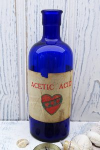 Antique cobalt blue bottle with original label for Acetic Acid, Duckworth & Co, Old Trafford Essence Distillery, Manchester. Early 1900's.
