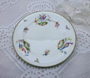 Antique Royal Doulton china tea plate depicting exotic pheasants, butterflies, moths and flowers.