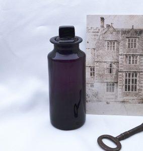 Georgian amethyst glass pharmacy bottle, original stopper, circa 1830 hand blown plum apothecary bottle, pontil mark on base, purple bottle