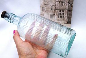Antique large aqua oval poison bottle, embossed Not To Be Taken Poisonous ~ ribbed, original rubber stopper, internal thread, chemist bottle
