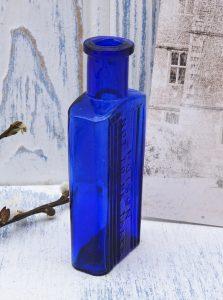Antique cobalt blue poison bottle, Victorian rectangular ribbed bottle, embossed Poison Not To Be Taken.