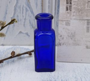 Victorian square cobalt pill bottle with chamfered corners
