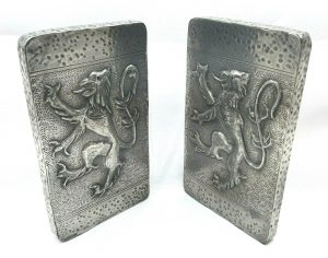 Vintage pewter pair of Arts & Crafts style heraldic hanging plaques depicting lions rampant in a Gothic style.