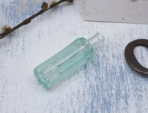 Antique Chinese opium bottle, tiny ribbed aqua glass bottle, Chinese words embossed on base.