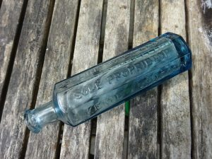Victorian octagonal aqua medicine bottle ~ Collins' Cough Elixir, Sole Proprietor J. Kemp Lincoln.
