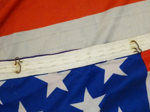 Vintage American flag, stars and stripes, 50 stars, 19600's, silk, with curtain hooks at top. USA flag, double sided. Hang in window or pole