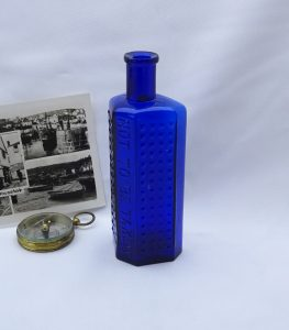 Victorian hobnail cobalt blue glass poison bottle, 4 ounce irregular hexagon with flat back and Not To Be Taken on front.